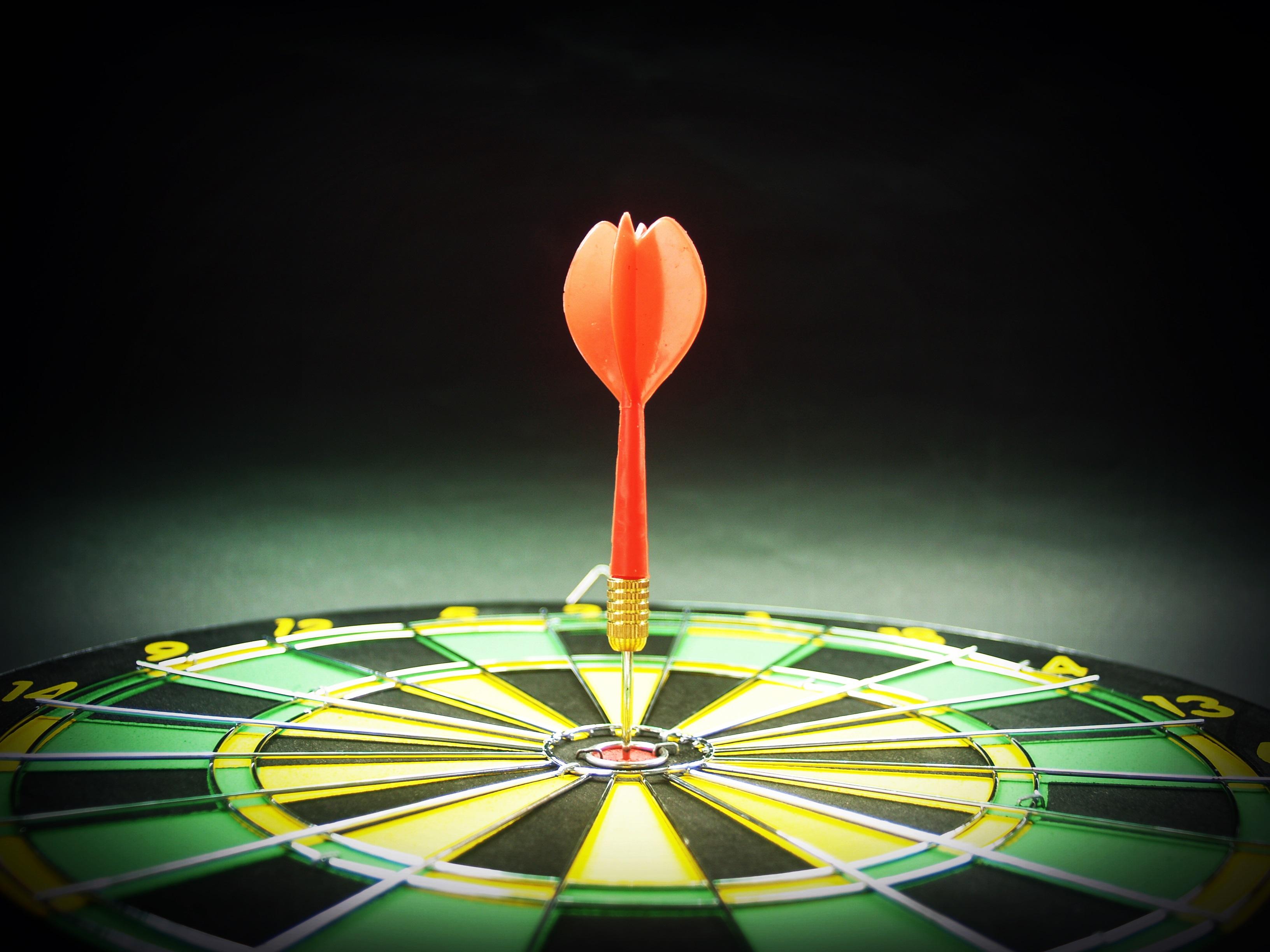 dartboard target aim goal achievement concept