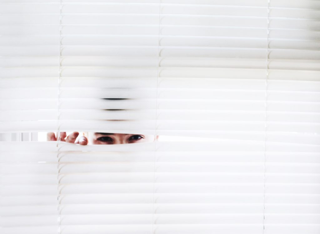 hiding person